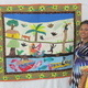 Marielle Lorge of Haiti shows off her latest art quilt.