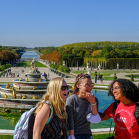 students in front of a fountain in europe