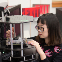 student working on a machine