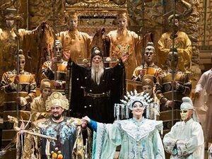 costumed opera singers performing on stage