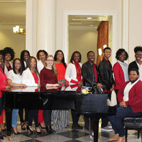 gospel singers around a piano