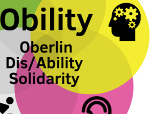Photo of the Obility Logo. Five intersecting circles each containing different symbols are shown. Moving clockwise: Blue circle and a symbol of an Eye, Yellow circle and symbol of a head with gears located in the area of the brain, Pink circle with symbol of an ear, White circle with a symbol of a person in a wheelchair, Green circle with symbol of a brain. In the middle are the words