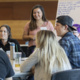 Students around a table at a past Wolf Pack Community Howl