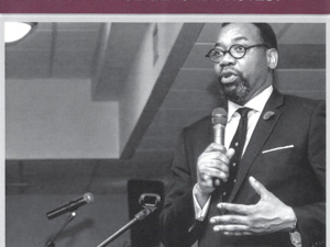 Rev. Bowen speaks with a microphone. Text of the flyer is repeated in the event description.