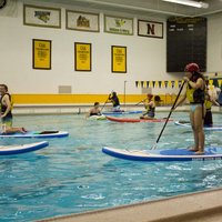De-Stress Fest– Gentle Stand Up Paddle Board Yoga in the Pool