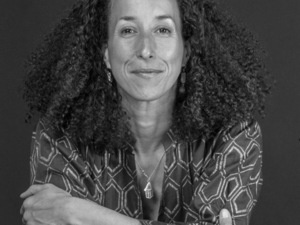 black and white photos of woman with long curly hair and patterned blouse.