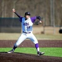 Kenyon baseball fielder ready to throw the ball