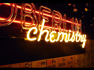 Photo of department display case, neon glass lettering spelling