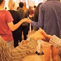 Holding hands during a service