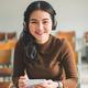 image of female student wearing headphones