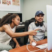 Two SOU students work at a computer