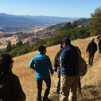 Environmental Science students hike on a trail during field work