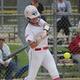 USI softball player about to hit softball with bat