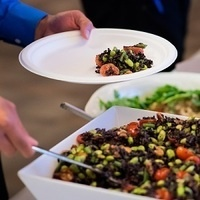 serving bean salad from a shared bowl