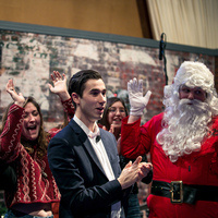 Oswego students and Santa Claus celebrate wrapping Christmas special