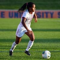 Adrienne Vaughn controls the ball on the field