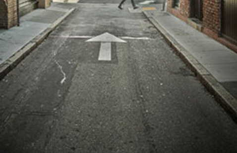 Street with a white arrow painted on