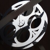 A camera reel and film strip