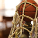 photo of basketball trophy with a net.