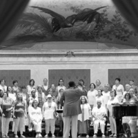 Photo of a choir on stage singing.