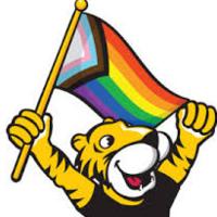Doc holding the pride flag