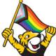 Doc holding pride flag