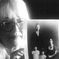 Emiko Omori holding family photo