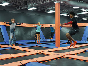 People jumping on trampolines at indoor facility