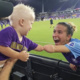Carson Pickett of the Orlando Pride celebrates with a young fan, in a connective moment celebrating everybody's abilities