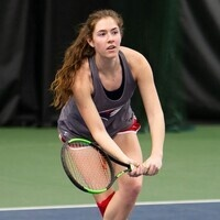 USI Women's Tennis team member holding racket