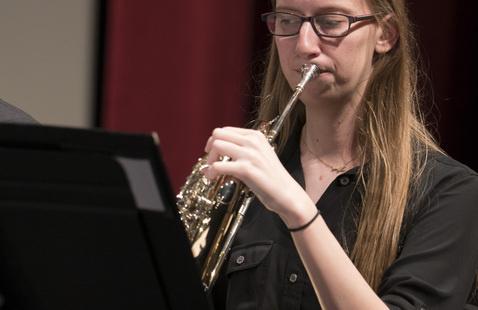 A student plays an instrument.