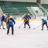 players on ice playing broomball