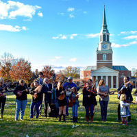 The Unbroken Circle poses in front of Wait Chapel.