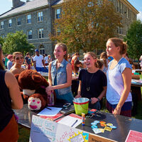Student engage at the activities fair.