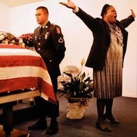 Peter Turnley, A wake for Essau Patterson, a US soldier killed in Iraq in Ridgeland, South Carolina, 2004, Archival pigment print