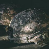 Soldier's helmet sitting on the ground