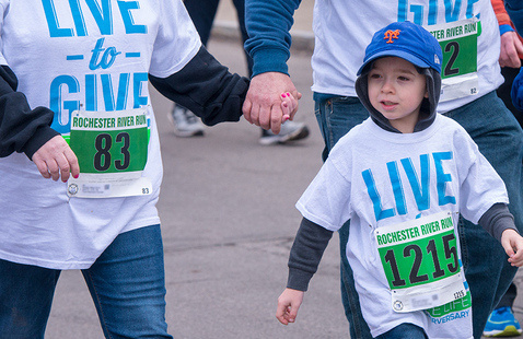 Families participate in the Walking portion of the River Run/Walk 5K in 2019.