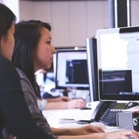 Students collaborating at computer
