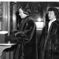 "Two Goucher students from the Class of 1950 purchase tickets to ""Joan of Arc"" starring Ingrid Bergman, showing at the Town Theatre on Fayette Street, circa 1948."