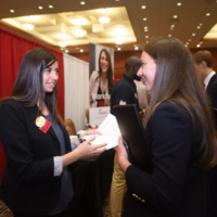A student talking to a recruiter.