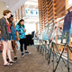 NC State students browse the artwork of fellow students.