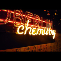 "Department display featuring ""OBERLIN chemistry"" in glass-blown, lit lettering"