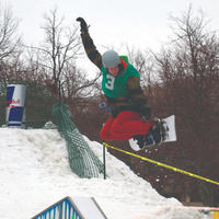 Student snowboarder takes air on the quad