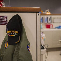 Veterans' coat and hat hanging in USI Dental Hygiene Clinic