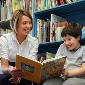 Teacher reading to student