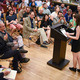 A graduate reads during a past MFA in Creative Writing graduate reading event.