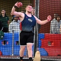 USI Men's Track and Field member throwing shot put