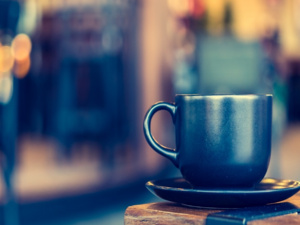 Image of a coffee cup sitting on a saucer
