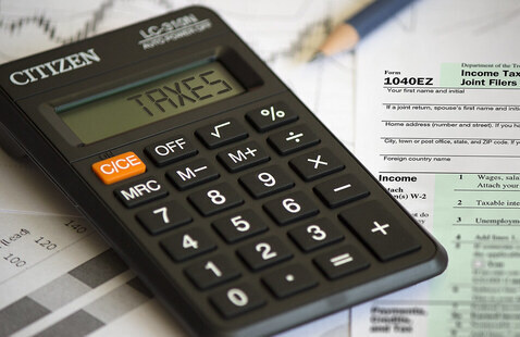 """""""Taxes - Calculator Image"""" by efile989 is licensed under CC BY-SA 2.0"""