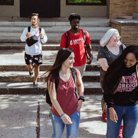 Five SOU students walk on campus